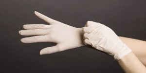 Female hands in latex gloves